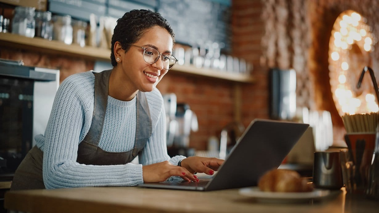 photo of small business owner looking at computer