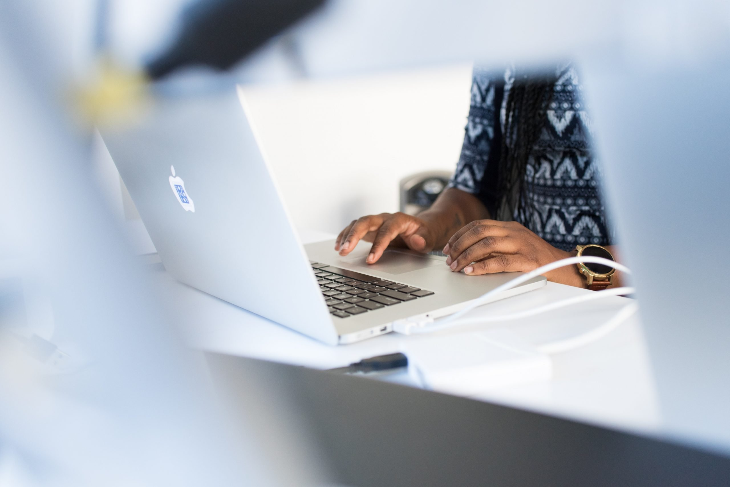 photo of Black woman typing on laptop