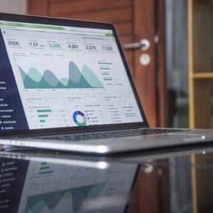photo of laptop with website analytics report