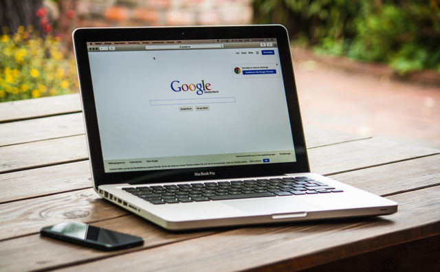 photo of a laptop accessing the Google homepage